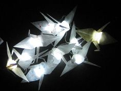 SO MUCH YES! Origami cranes on top of LED Christmas lights! <3