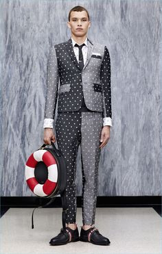 Color blocking and a fun rift on polka dots come together for a fun suiting number by Thom Browne.