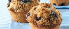 Whole wheat flour, a touch of honey and frozen organic blueberries star in classic blueberry muffins.