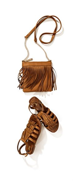 Fringe and gladiator styles remain a strong trend this spring, especially in this shade of cognac. #looksforless #accessories #sandals #purse #springfashion #boho #bohemian