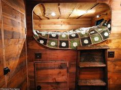 Former surveyor Guy Williams spends converting a wrecked horse box into a plush 'log cabin van' Motorhome Conversions, Horse Wagon, Travel Around Europe, Horse Trailers, Douglas Fir, Upholstered Sofa, Travel News, House On Wheels, Back In The Day
