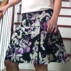 "Allen B. Floral Box Pleat Skirt Zip back closure. Pleated construction. 20"" length. 90% polyester/ 10% spandex Allen B Skirts"
