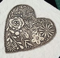 Heart on textured wooden canvas done by Gail at Pewter Boutique.