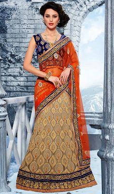 Beige Embroidered Net Lehenga Choli Beige net lehenga choli is heavily embellished with resham and pita work enhanced foliage patterns. Contrasting hemline patch contributes to the beauty of the attire. Comes with a matching stitched round neck blouse with 6 inches sleeves. #HeavyEmbroideryGhagraCholi #BridalLehengaOnline