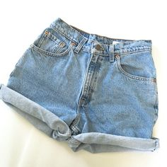 """Levi's High-Waisted Shorts Levi's High-Waisted Shorts // Levi's 550 relaxed fit // tag says 9 junior // waist 14"""" / 12.5"""" length cuffed / 11.5"""" rise // 15"""" length uncuffed // non-smoking home  20% off 2+ Bundles // Same Day or Next Day Shipping!! 4.9.29 Levis Shorts Jean Shorts"""