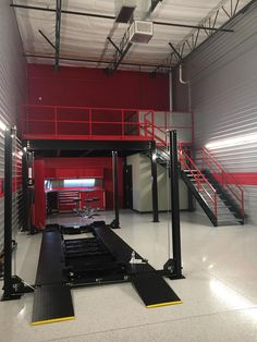Have you heard of Toy Barn Luxury Garages? Just like a condominum, they create a very personalized space for the owners and their toys. Barn Garage, Garage Shop, Garage Plans, Garage Workshop, Dream Garage, Garage Interior, Garage Furniture, Automotive Furniture, Automotive Decor