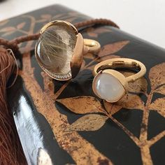 Precious and unique design by Charlotte Lynggaard. The Lotus Collection. Here the rings are in rutile quartz with diamonds and in white moonstone - Ole Lynggaard Copenhagen - Charlotte Lynggaard