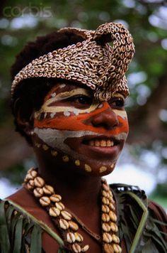 Papua New Guinea | A Sepik River tribeswoman wearing face paint, necklace, and headdress | © Keren Su