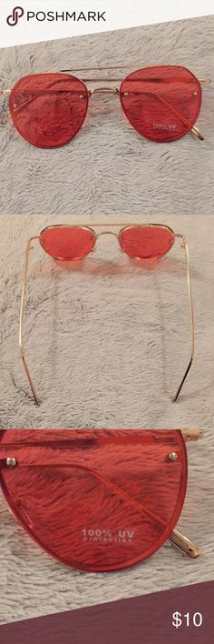 Pink Tinted Urban Outfitters Sunglasses Brand new pink tinted sunglasses from Urban Outfitters, never worn, slightly too big for my head Urban Outfitters Accessories Sunglasses
