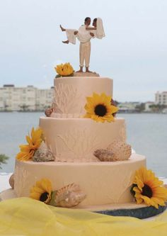 Wow - Sunflowers and shells decorate the wedding cake