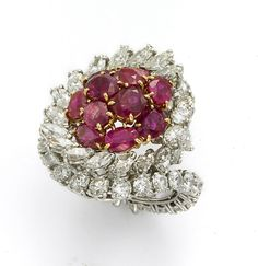 CARTIER, PARIS RUBY AND DIAMOND COCKTAIL RING      Spectacular and glorious, a great and impressive ring by Cartier Paris from the 1960's, with 8 carats of brilliant diamonds set in platinum that go all around the shank, and 6 carats of luscious Burma rubies set 18k gold.
