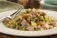 Our take on the Asian classic of fried rice starts with healthy brown rice and gets lots of tasty flavor from the peas, carrots, and ham! We think this is The Best Ever Brown Fried Rice, and we hope you do, too!