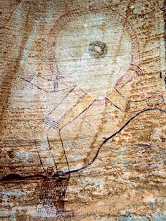 A roundhead painting, possibly 8,000 years old, in Algeria's Tassili n'Ajjer that may be part of a shamansitic scene