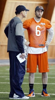 Marc Trestman and Jay Cutler confer. Jay dont look too happy!