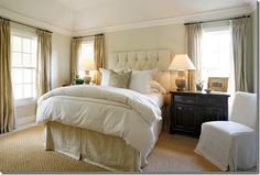 Clean, bright and neutral master bedroom.  Very calming.