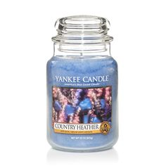Country Heather by Yankee Candle. A unique blend of soothing floral and herbal notes.  This candle reflects a warm, relaxed sense of style that's always at home.  This fragrance goes well out in my front patio.  Photo: Madamegourmand.com