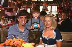 Phillipp Lahm (left) poses for a picture at Oktoberfest alongside his wife, Claudia and th...