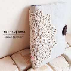 Crochet doily & linen card holder case. Wouldn't this make a nice gift - perhaps on a journal or a wedding album?