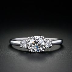 love this simple, classic, dainty three stone setting