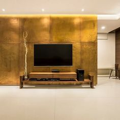 A luxurious home of 2500sq.ft carpet designed by Indoors design, Surat. Unusual palette of materials and colours come together for this elegant home in Surat. Materials used in their purest form come forming clean lines giving the home its distinct warmth. Bedroom Tv Unit Design, Tv Wall Design, Tv In Bedroom, Tv Unit Furniture, Modern Tv Wall Units, Room Interior, Interior Design, Living Room Tv, Carpet Design