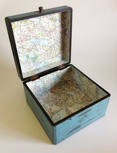 Treat map with coffee or tea or a watercolor brown wash to make look old. Line a box with this and turn it into a treasure box.