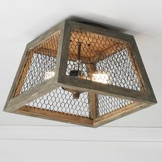 Chicken Wire Square Shade Ceiling Light Weathered wood and chicken wire ceiling light blends the vintage charm of rustic French villas with today's love of geometric shapes! Ceiling Light Shades, Ceiling Light Design, Ceiling Light Fixtures, Lighting Design, Wire Light Fixture, Ceiling Light Diy, Square Light Fixture, Wood Pendant Light, Pendant Lights