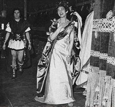 Maria Callas looking happy after a performance of Donizetti's Poliuto with Ettore Bastianini in the background
