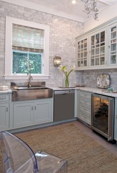 This isn't at all possible for my current house...but maybe someday. Light grey stone back splash, very natural and airy.
