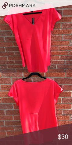 Red Express top. Brand new with tags, never worn. Comes from a smoke free and pet free home. Moving soon so I need sell as quickly as possible. Accepting all reasonable offers but please use the offer button. Express Tops Blouses