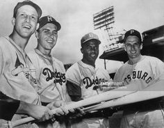At Brooklyn's Ebbets Field, Stan Musial, outfielder for the St. Louis Cardinals, Gil Hodges, first baseman for the Brooklyn Dodgers, Jackie Robinson, second baseman for the Dodgers, and Ralph Kiner, outfielder for the Pittsburgh Pirates, pose before the start of the 1949 All Star game on July 12.