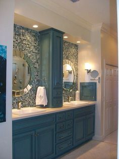 Eclectic Master Bathroom with specialty door, Limestone counters, American Olean Visionarie Serenity Blue Glass Mosaic