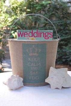 engagement gift-burlap wrap bucket with bride magazine, hershey kisses, ring pop and bottle of champagne
