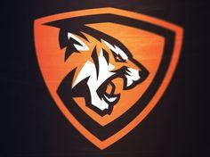 School of the Orange Tiger's. Hockey Logos, Sports Team Logos, Soccer Logo, Dek Hockey, Tiger Logo, Game Logo Design, Badges, Mascot Design, Logo Sticker
