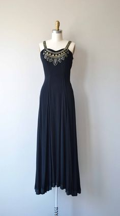 Vintage 1930s black rayon crepe dress with amazing mixed metal beaded neckline, wide shoulder straps, princess seams, seamed waist, long graceful skirt and metal side zipper. Amazing. --- M E A S U R E M E N T S ---  fits like: xs bust: 32-34 waist: 25.5 hip: free length: 59 brand/maker: n/a condition: excellent  ✩ layaway is available for this item  To ensure a good fit, please read the sizing guide: http://www.etsy.com/shop/DearGolden/policy  ✩ more vintag...