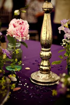 When done right, purple & gold can be so elegant.  Also, the gold candelabria speaks to the era.