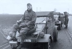 A soldier taking a break on his Type 82 Kubelwagen