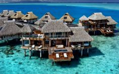 There are dozens of overwater bungalows resorts in Bora Bora, the Maldives and Fiji, but where are the luxury overwater bungalows and what price can you expect to pay? Dream Vacation Spots, Vacation Places, Honeymoon Destinations, Dream Vacations, Places To Travel, Honeymoon Ideas, Honeymoon Suite, Holiday Destinations, Bora Bora Honeymoon