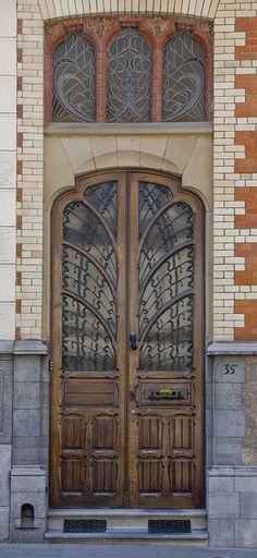 Rue Le Corrège 35, Brussels.  Is the whole city of Brussels populated with fabulous architecture?  This door and amazing window seem so unassuming ... and yet are so amazing compared to the usual sights in the U.S.