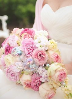 Whimsical wedding bouquet with iridescent glass bubbles and pink roses