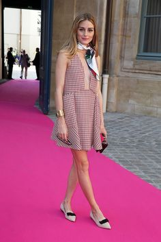 Olivia palermo wears a plaid mini dress by Dior with a neckerchief and ballet flats