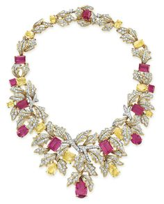 A DIAMOND, RUBELLITE TOURMALINE AND YELLOW SAPPHIRE NECKLACE, BY DAVID WEBB Of foliate motif, designed as a graduted cluster of circular-cut diamond leaves, set with variously-shaped rubellite tourmalines and yellow sapphires, mounted in 18k gold and platinum, circa 1965