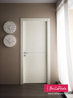 Interior Doors made in Italy New 2010 collection. Modern style interior door with squared frame, one horizontal metal insert in the center, equipped with magnetic lock, adjustable pivot hinges as standard, optionally available with completely concealed hinges.