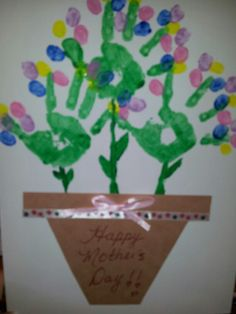 Mother's Day craft for daycare kids! Handprints with finger print flowers!!