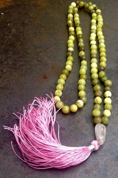 Mala beads with green new jade / serpentine and a pink, pure silk tassel by ThePillowBook maker of handmade prayer beads.