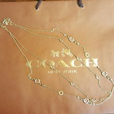XLong double Strand coach necklace crystals n glas Gorgeous long piece. Gently used 100% authentic coach. Op art c circles, clear circles and crystals. Log leash clasp with gold toned coach hangtags. Coach Jewelry Necklaces
