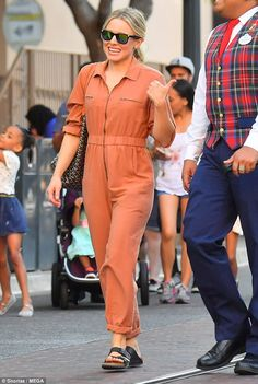 6d7a63b5ac97 Kristen Bell sports orange jumper to Disneyland with Sarah Silverman