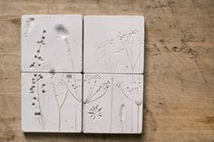 Perfect for a splashback, this design has been created by pressing wild flowers into the clay, then finishing with a white glaze.
