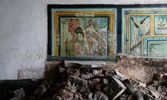 A damaged wall inside an abandoned cave house in the deserted village. Photograph: Jason Lee/Reuters