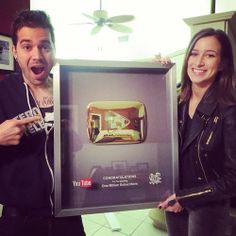 Charles  Alli Trippy getting their 1 million subscribers platform framed by YouTube #ctfxc