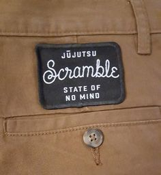 Scramble Camel Chinos. I'm always repping Scramble even when I'm not training. Anyone else use their Scramble iron-on patches on something other than a gi? #BJJ #FactoryBJJ #Fashion #ScrambleStuff @scramblebrandofficial